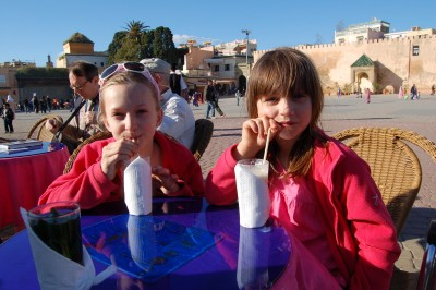 The girls enjoying their banana juice in the main square - a great place for sitting and just watching the world go by!